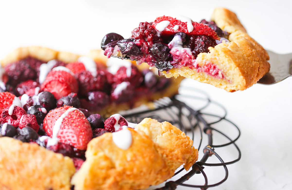 a slice of a berries and cream galette