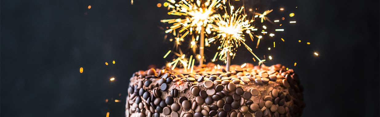 Sparkles on top of an Orgnaic Times chocolate cake
