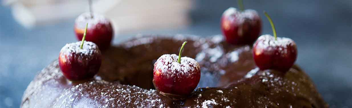 Cherries on top of a chocolte bundt cake