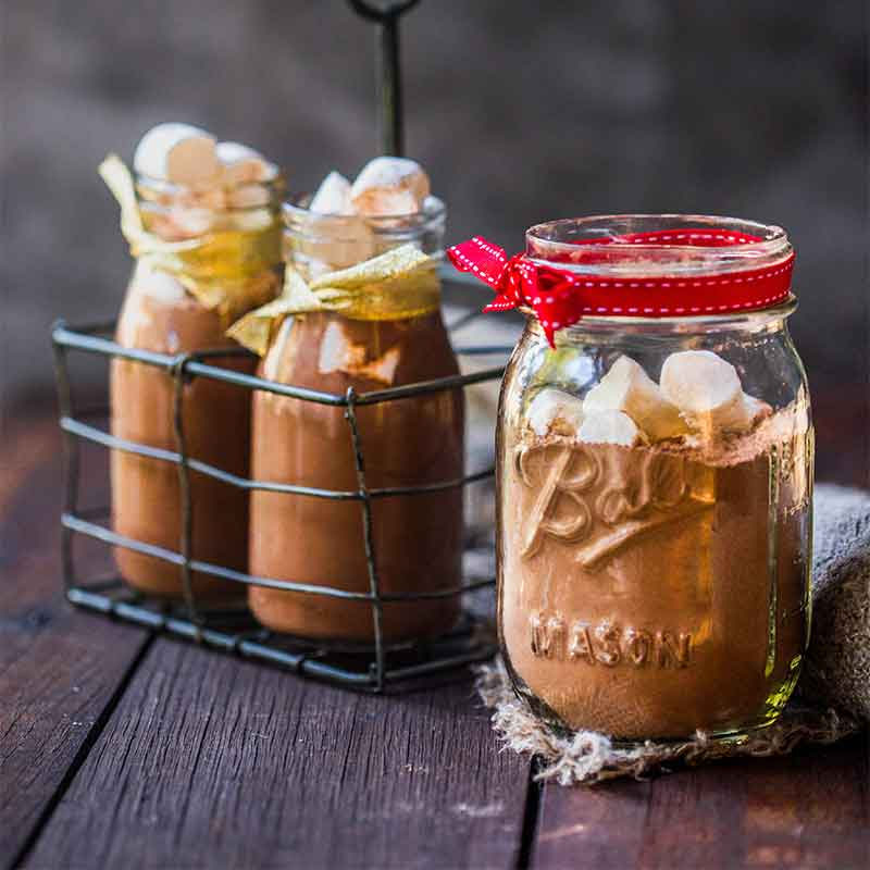 3 jars of Orgnaic Times drinking hot chocolate mix