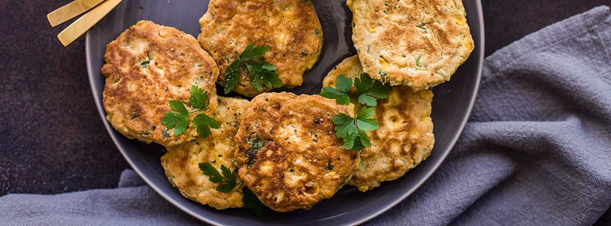 A plate of corn fritters
