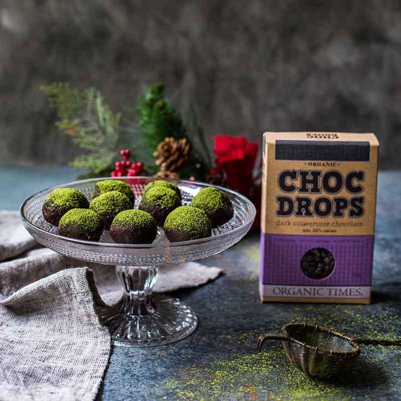 A box of Organic Times Dark Chocolate Drops next to Chocolate Matcha Truffles