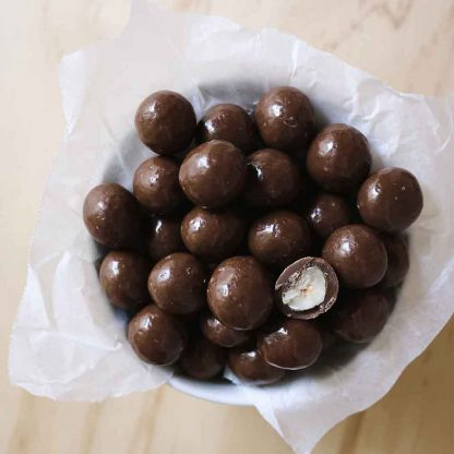 A bowl of Organic Times Milk Chocolate Hazelnuts
