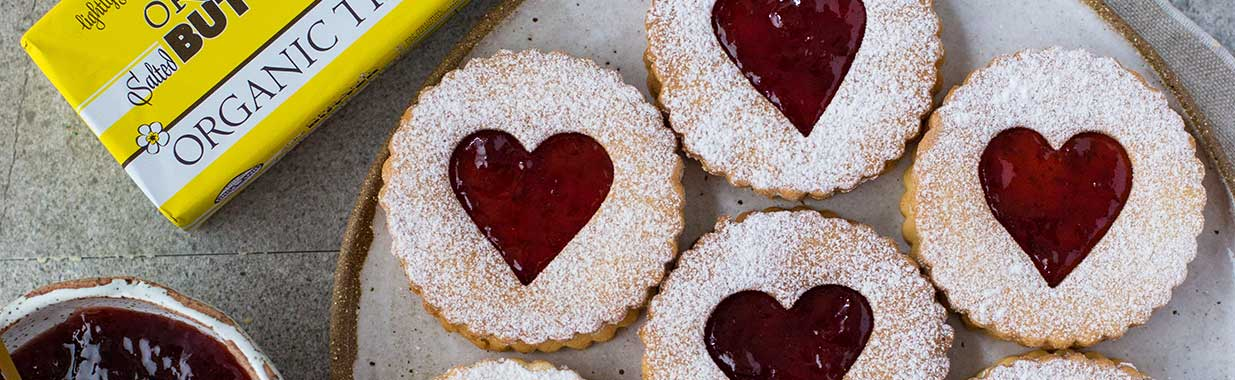 Organic Times Salted Butter next to a plate of Valentine's Day Shortbread and jam