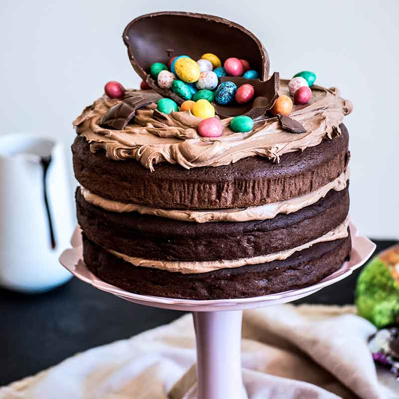 An Organic Times Easter Chocolate Cake on a stand