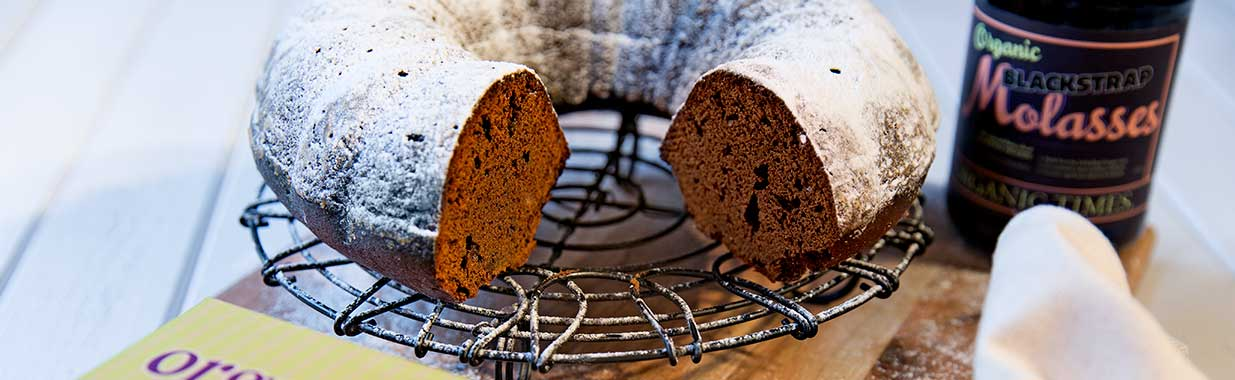 A Gingerbread Cake with a jar of Organic Times Molasses