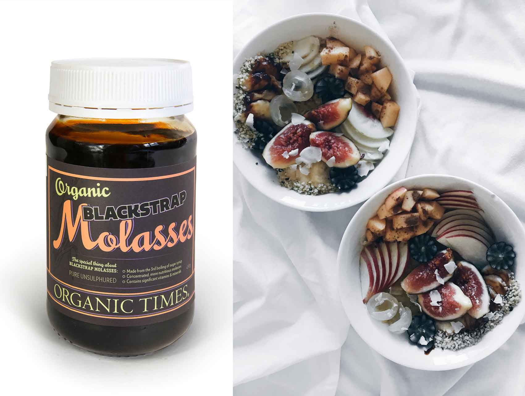 A jar of Organic Times Molasses next to a bowl of oatmeal topped with a variety of fruits