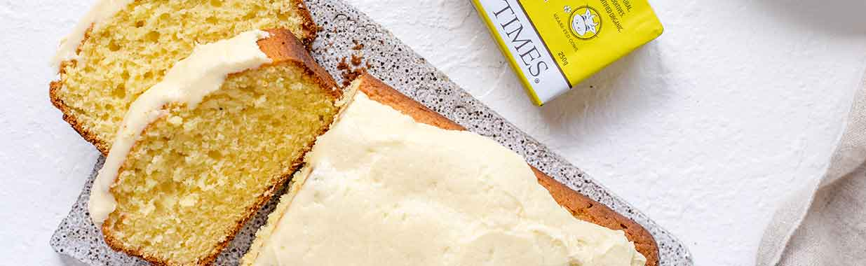 Madeira Cake slices next to Organic Times Butter