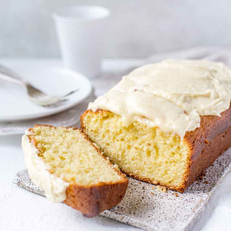 Sliced Madeira Cake with a plate and forks