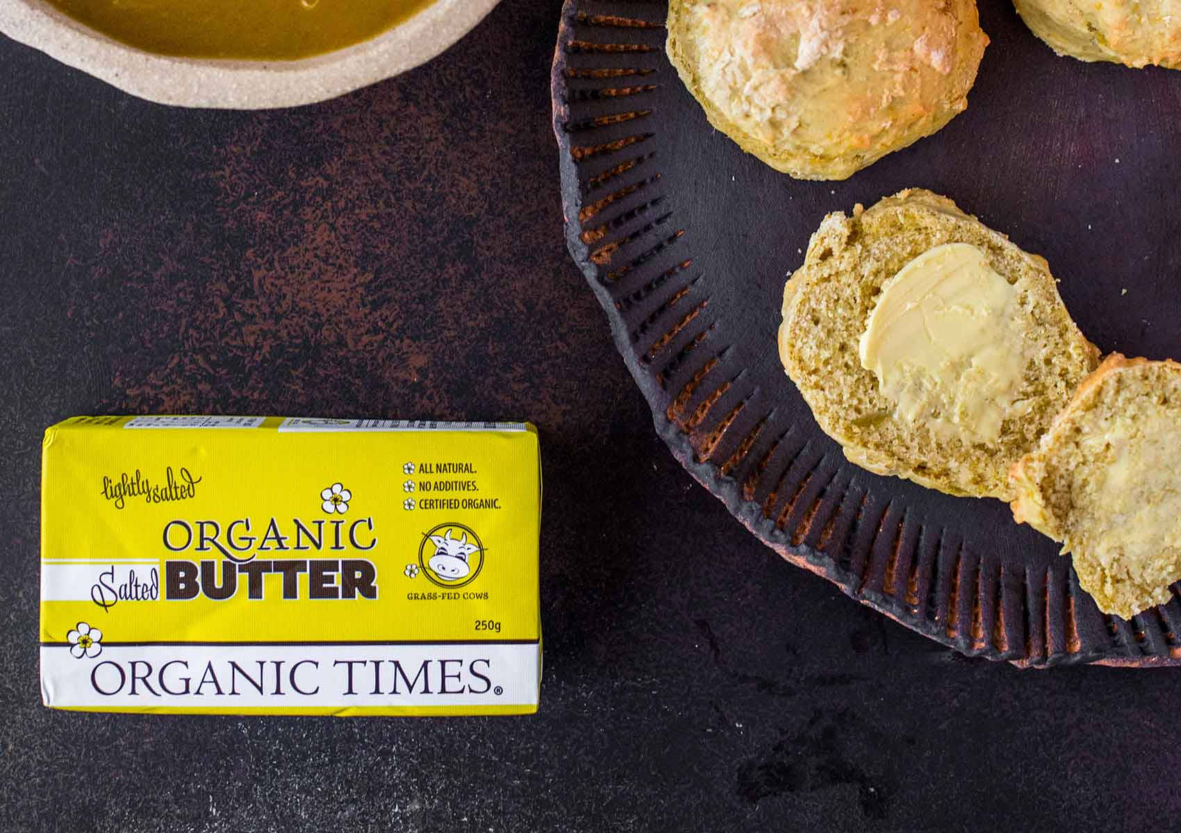 Organic Times Salted Butter next to a plate of Pumpkin Scones