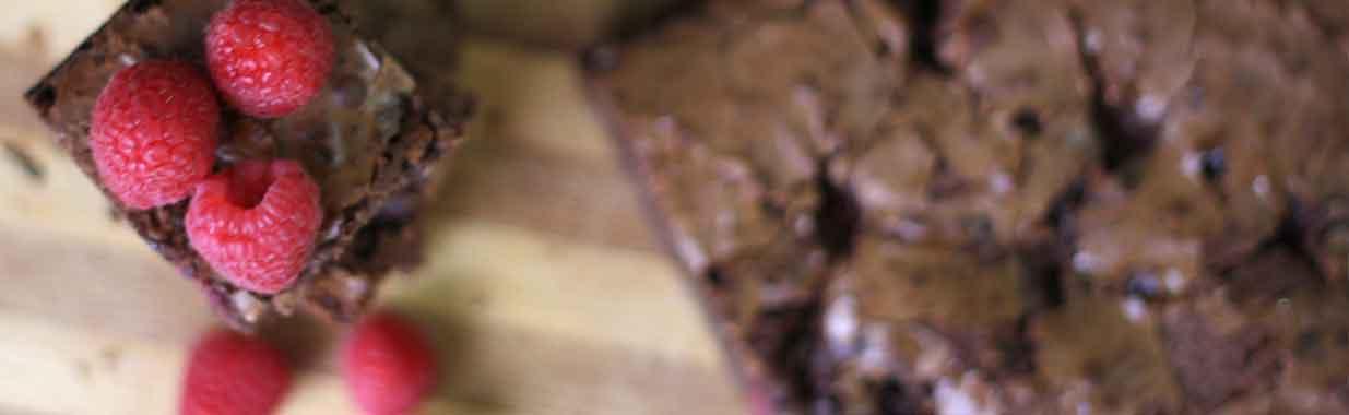 Fresh raspberries on top of a chocolate brownie