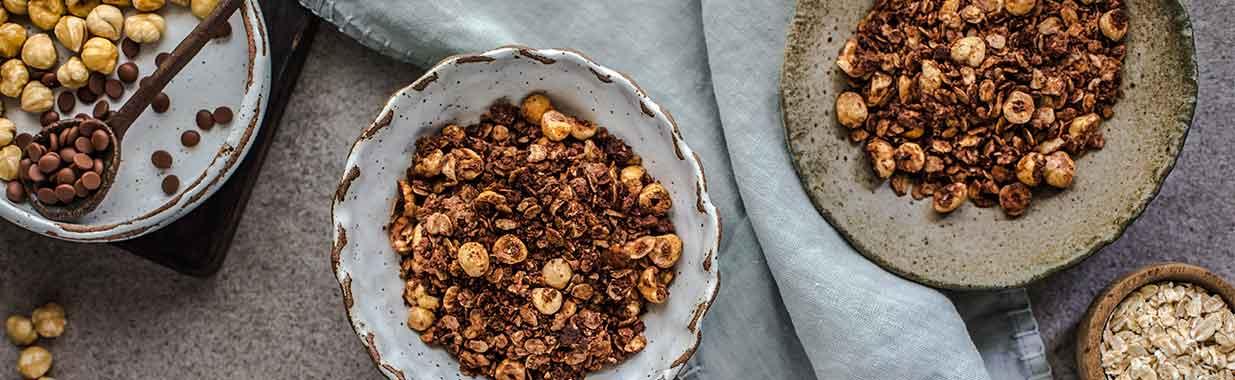 Bowls of Chocolate Hazelnut Granola and oats