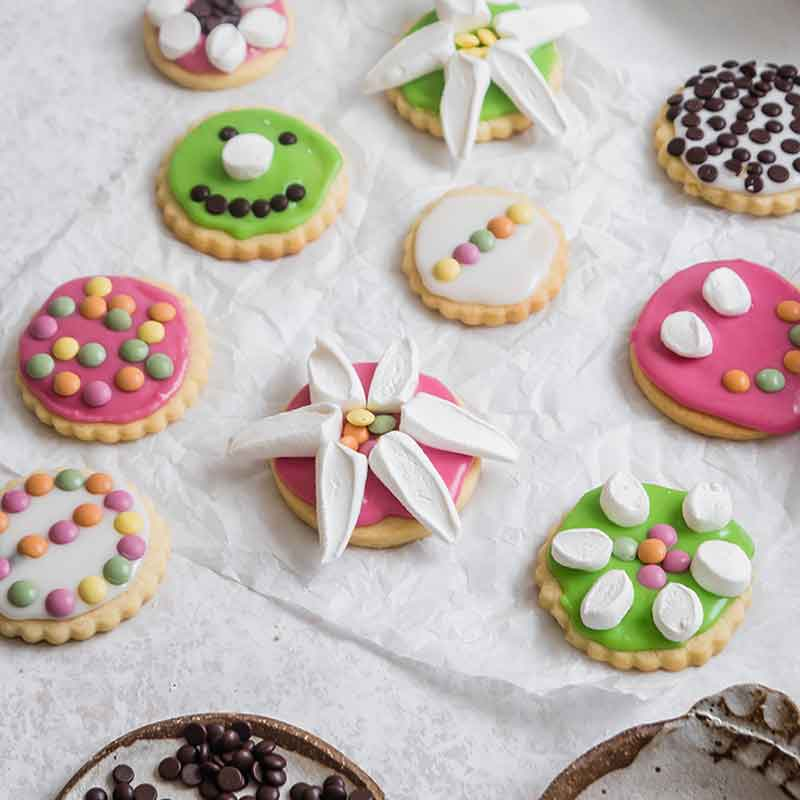 Sugar cookies topped with marshmallows and little gems and choc drops