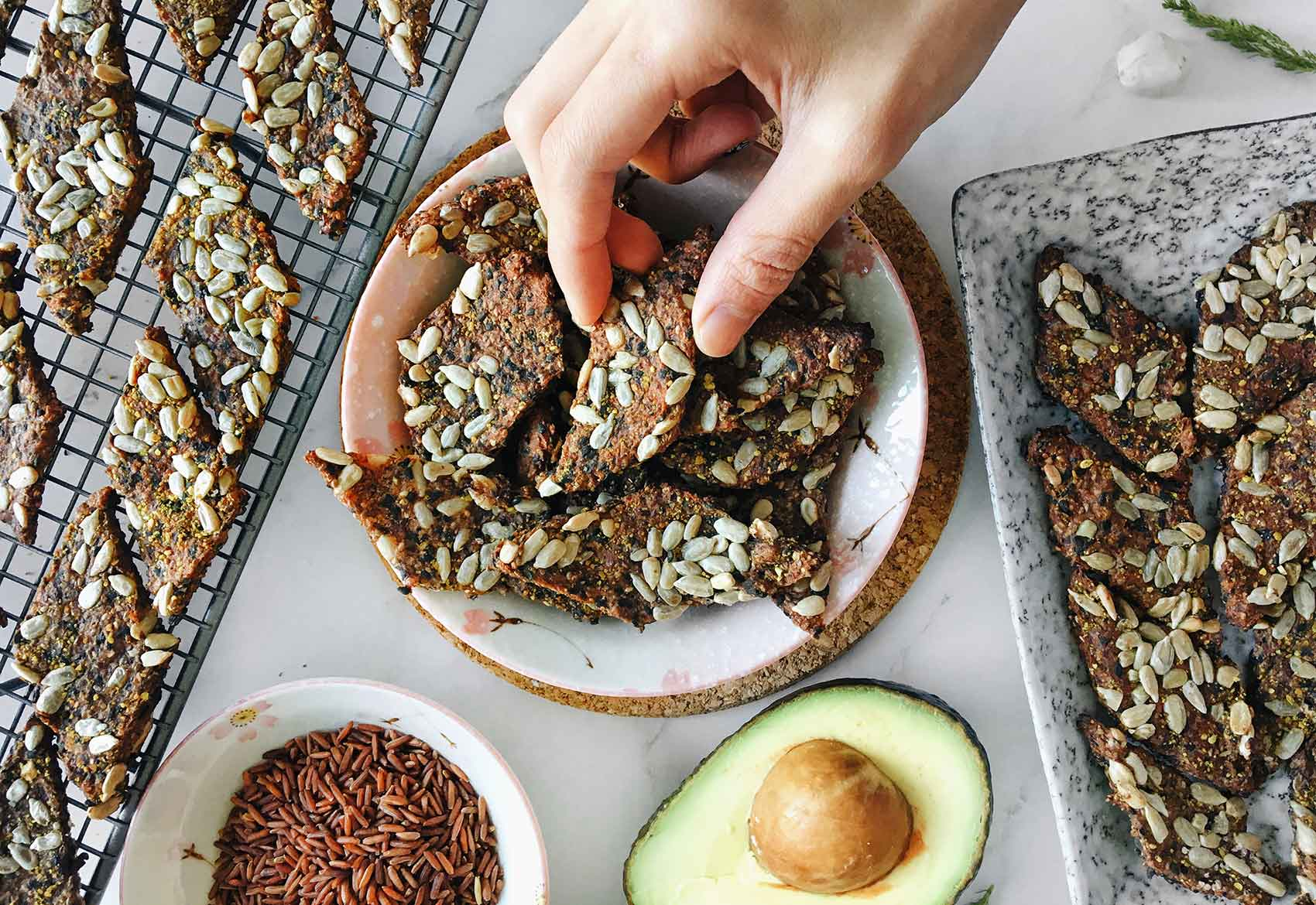 a bowl of organic times sunflower seed crackers