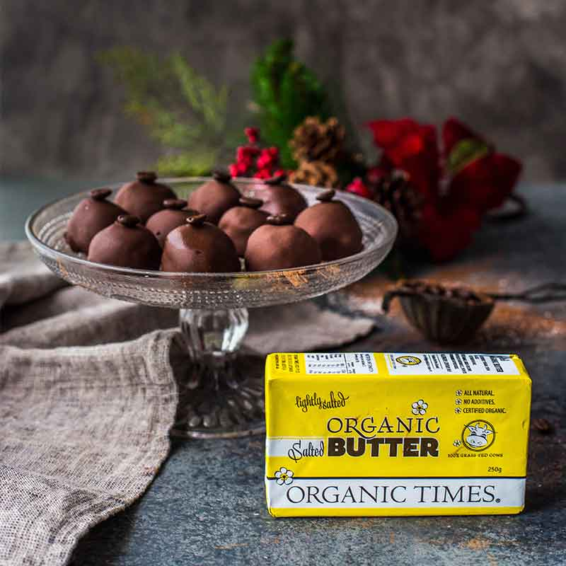 Organic Times Salted Butter next to a plate of organic coffee truffles