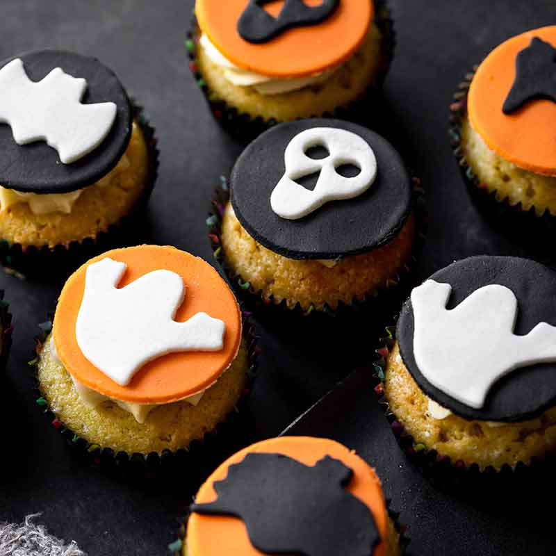 Vanilla cupcakes with halloween images on top