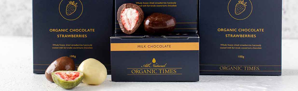 Organic Times chocolate coated strawberries on boxes