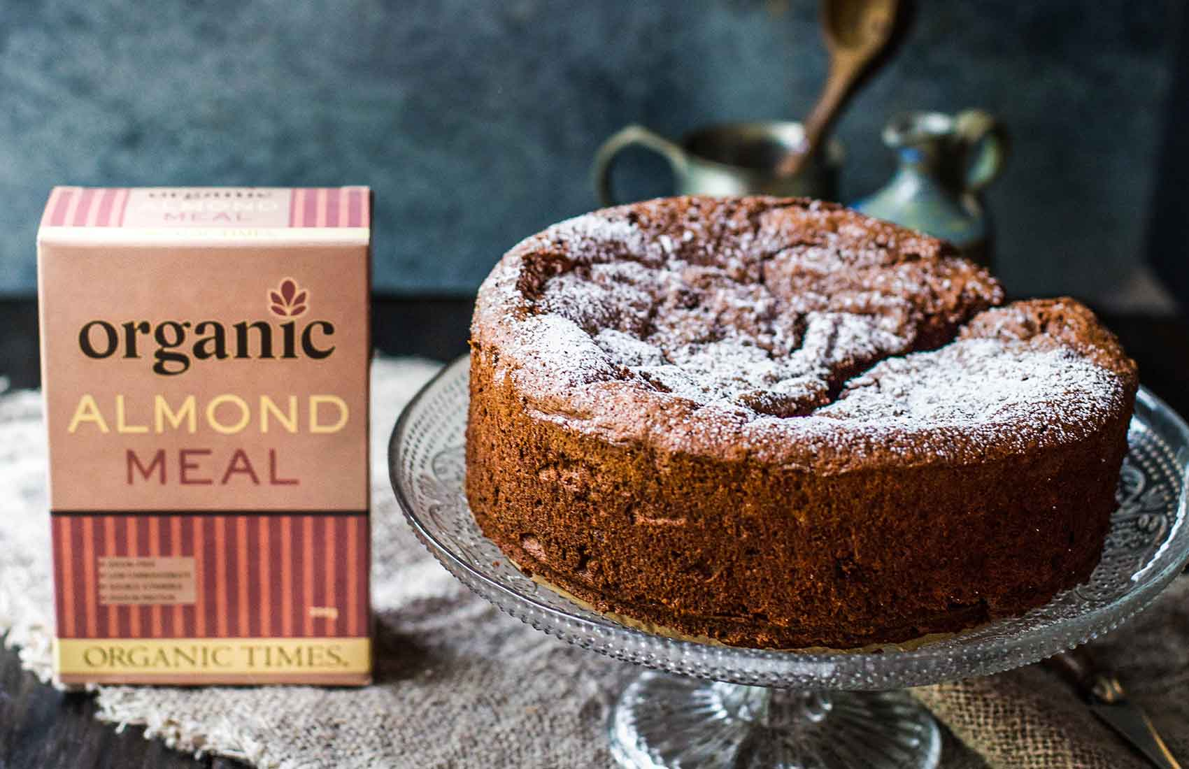 Organic Times Almond Meal box next to a chocolate berry meringue cake
