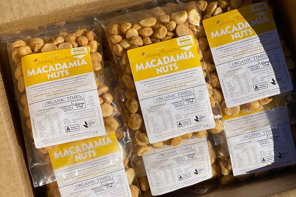 packets of honey macadamias in a box