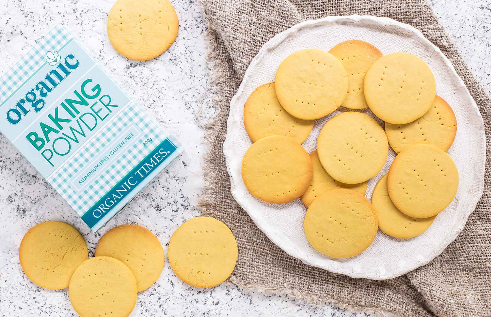 a plate of arrowroot biscuits next to organic times baking powder